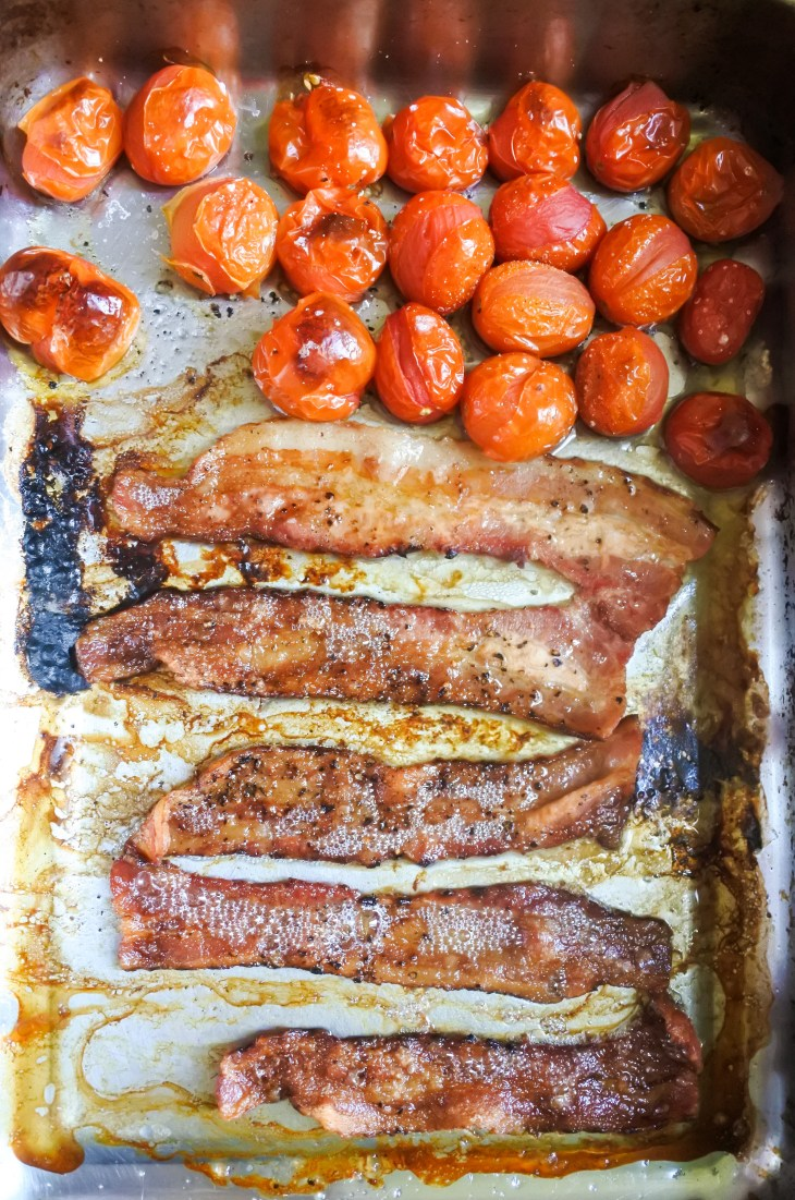 bacon and cherry tomatoes roasted in an oven tray