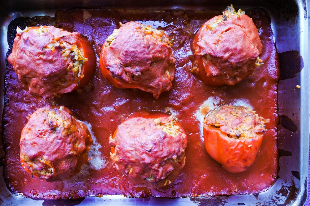 lamb stuffed red bell peppers are baking in the oven