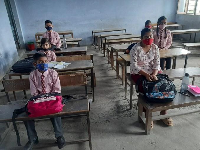 Children sitting with social distance at Nanauta Lord Krishna Public School.