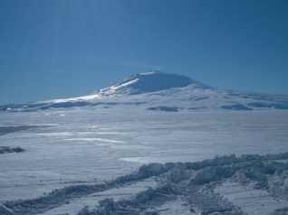 Mount Erebus, the southernmost active volcano. This is the view from LDB, where we will be working. Distance estimation is impossible here. The base of that mountain is 25 miles from LDB. I guessed a mile. I would have died if I were an Antarctic explorer in old times.