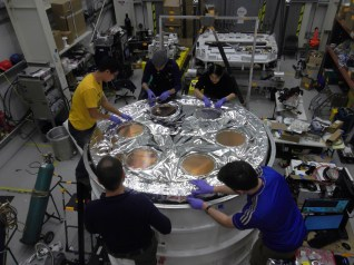 Many layers of aluminized mylar blanket the two vapor-cooled shields to insulate them from the warmer parts on their exteriors. Here, the last of the MLI is installed. This is my favorite stage of the assembly, since it is the shiniest stage.