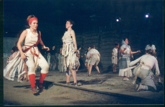 1994 production of Die in Debt, under the Gardiner Expressway. Randi Helmers runs across frame, with Alex Bulmer standing in foreground