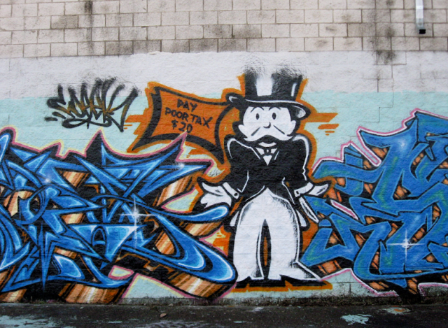 Graffiti featuring Monopoly Man asking for taxes.