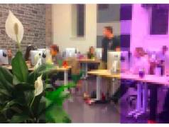 A pixelated image of students using computers