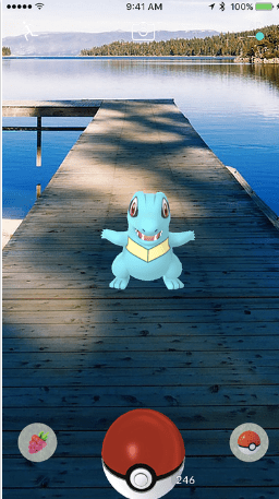 Pokemon Go Dragon on a dock at a lake in wilderness