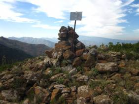 The top of Cerro del Aguila, I don't know what the sign used to say, you're here maybe?