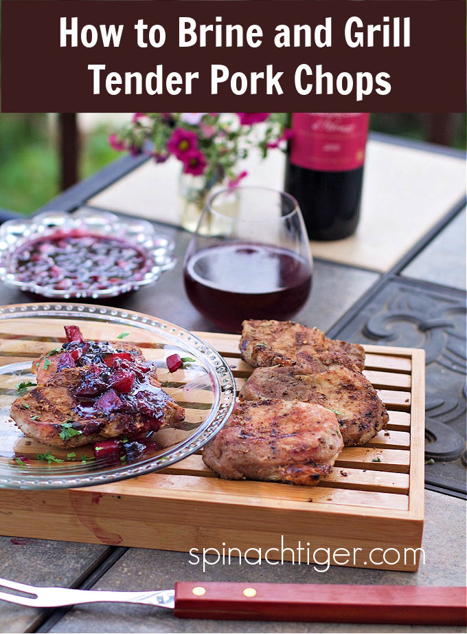 Brine ribeye pork chops to and grill the most tender pork chops ever. Top with a blueberry peach compote. #ribeyeporkchops #grilledporkchops #blueberrycompote #spinachtiger via @angelaroberts