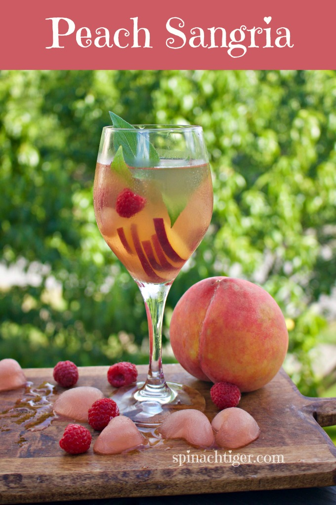 White Peach Sangria Made with Simple Syrup from Spinach Tiger
