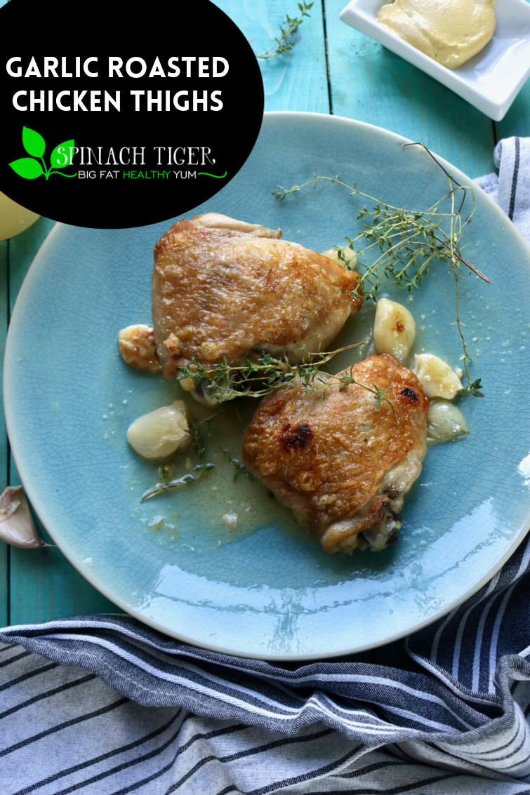 Garlic Roasted Chicken Thighs, an easy chicken dinner made with butter, thyme and fresh garlic. #chickenthighs #chickendinner #roastedchickenthighs #easydinners via @angelaroberts
