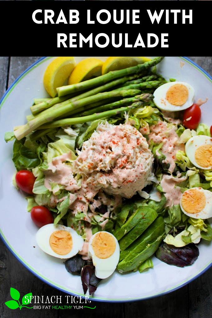 Crab Louis Salad is old school, elegant. Dating back to 1910, includes crab, asparagus, tomato, hard boiled egg and homemade remoulade sauce. #crablouis #spinachtiger #crabrecipe via @angelaroberts