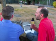 Gibson (left) and Lamar (right) atop the grave of Harvey Lillard while podcasting on SpinalColummnRadio.com episode 140.