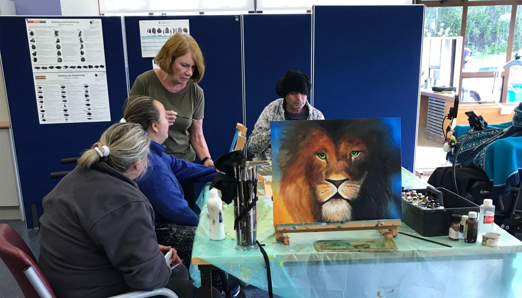 Mouth painting with picture of lion and Robiin tutoring