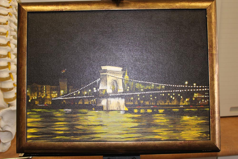 A photo of a mouth painting called Budapest Chain Bridge by Toni Leefe