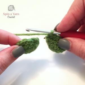 About to attach two crochet green tips together.