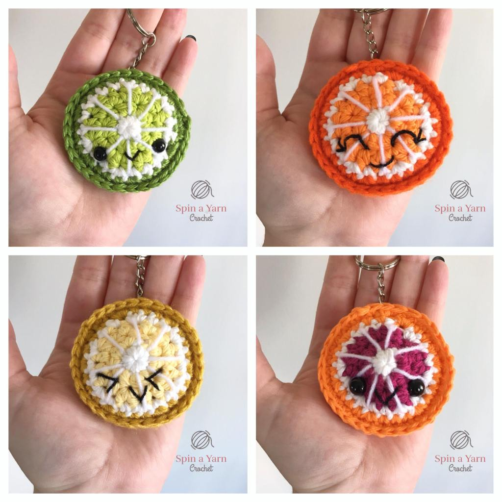Four citrus fruits in a hand