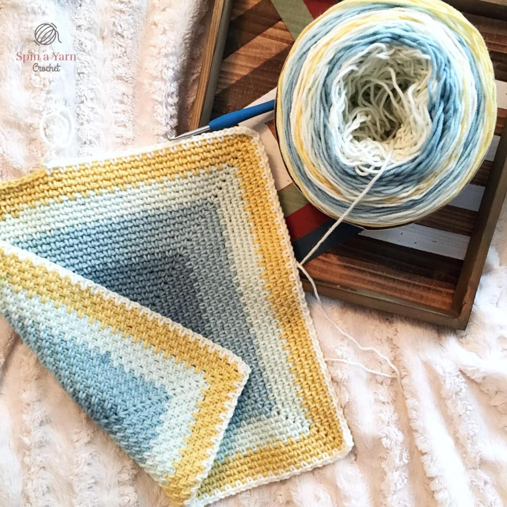 Partially completed moss stitch square blanket