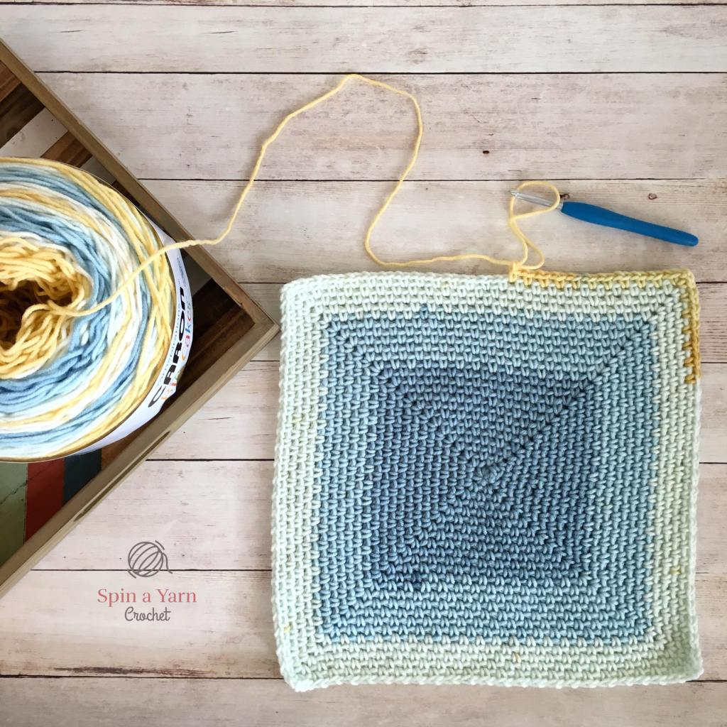 Parially completed moss stitch square blanket
