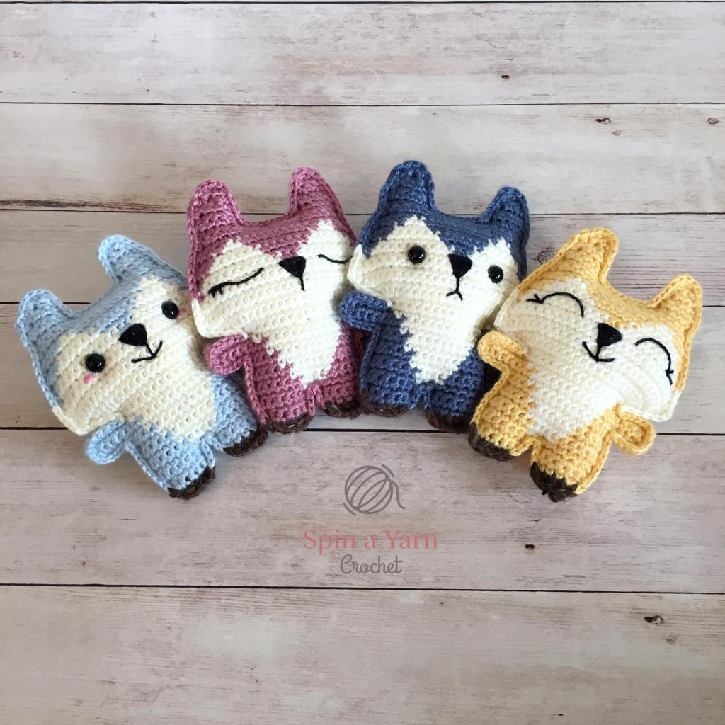 Four different coloured foxes