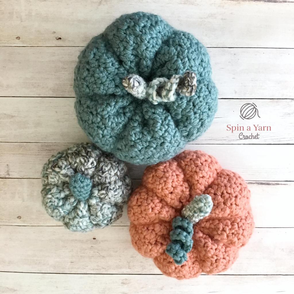 Three crocheted pumpkins in circle