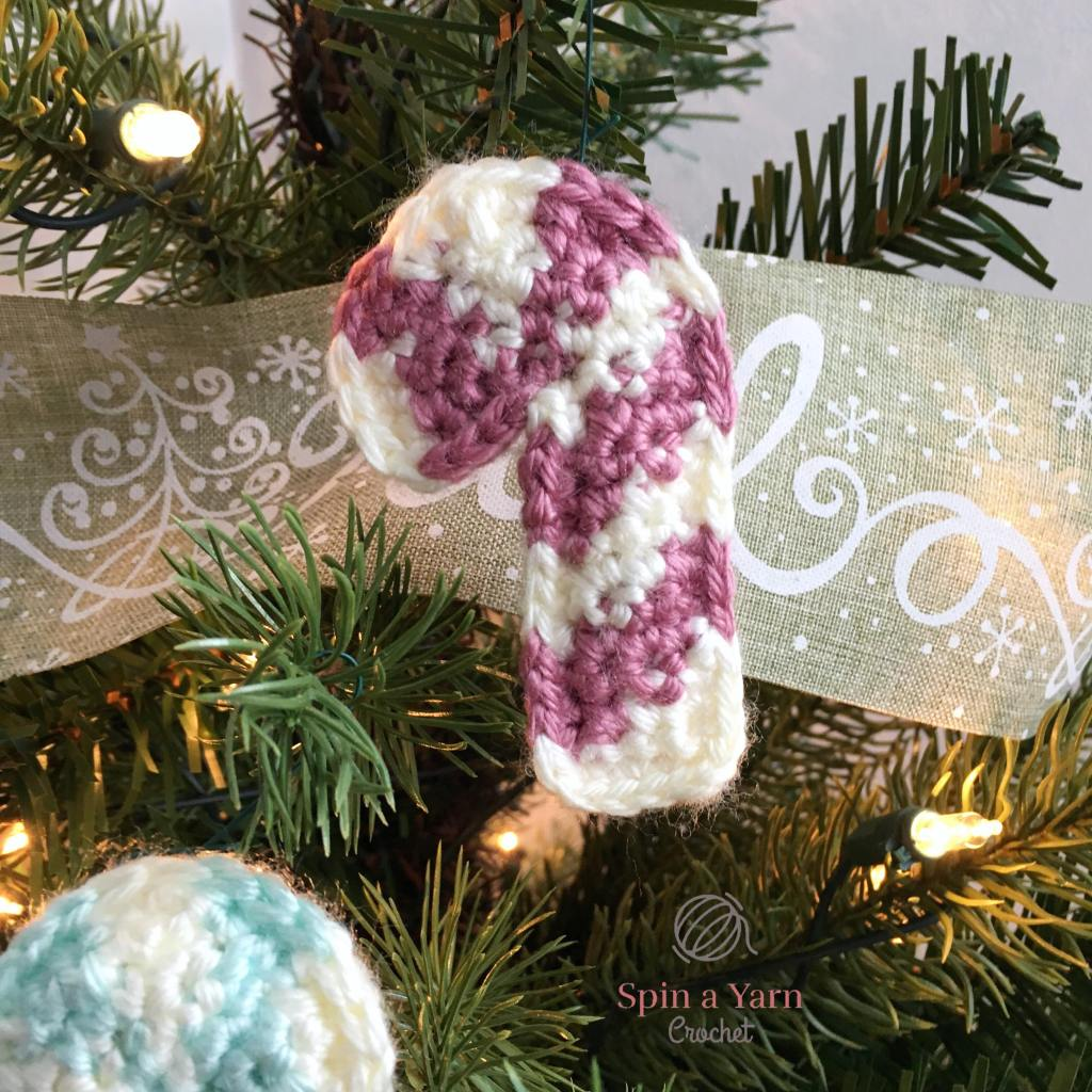 Candy cane ornament on tree