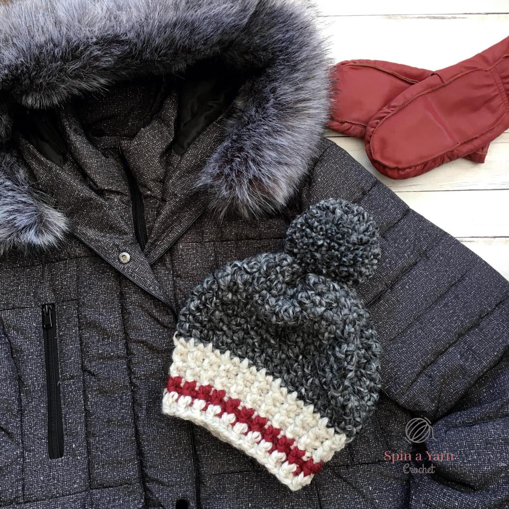 Work hat with winter coat and red mitts