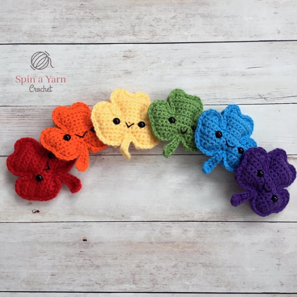 6 crocheted shamrocks in rainbow colours