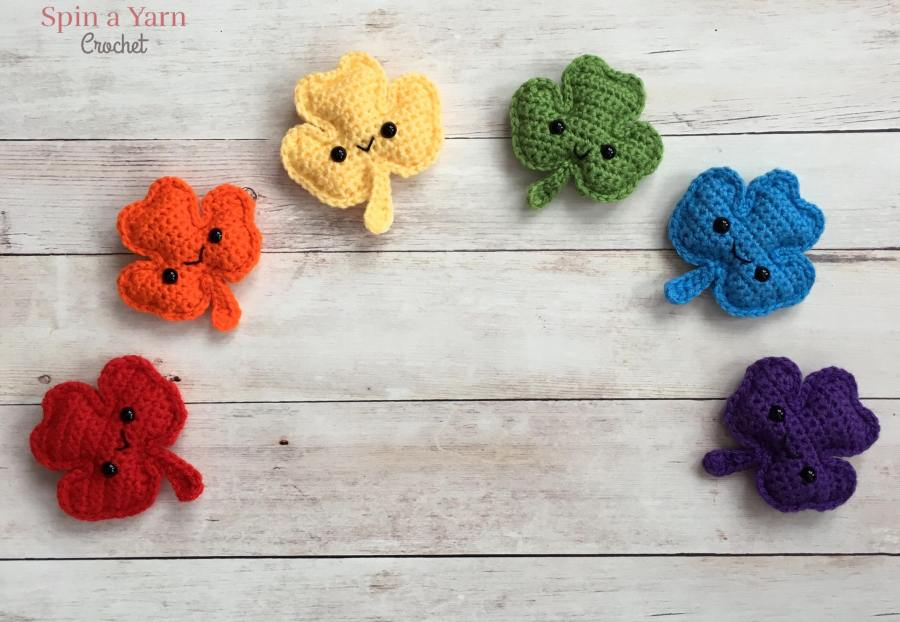 6 crocheted shamrocks in rainbow colours