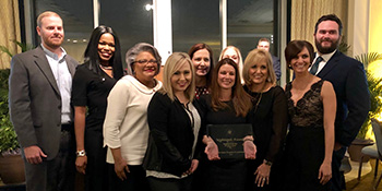 Group photo of Spine Hospital Nurses accepting 2019 LNF Hospital of the Year Award (