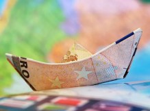 A picture of a boat made of money for blog: How to ask for money.