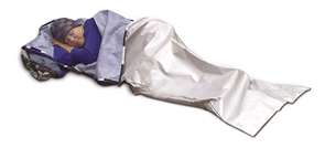 A camper demonstrates the emergency sleeping bag that maintains body heat