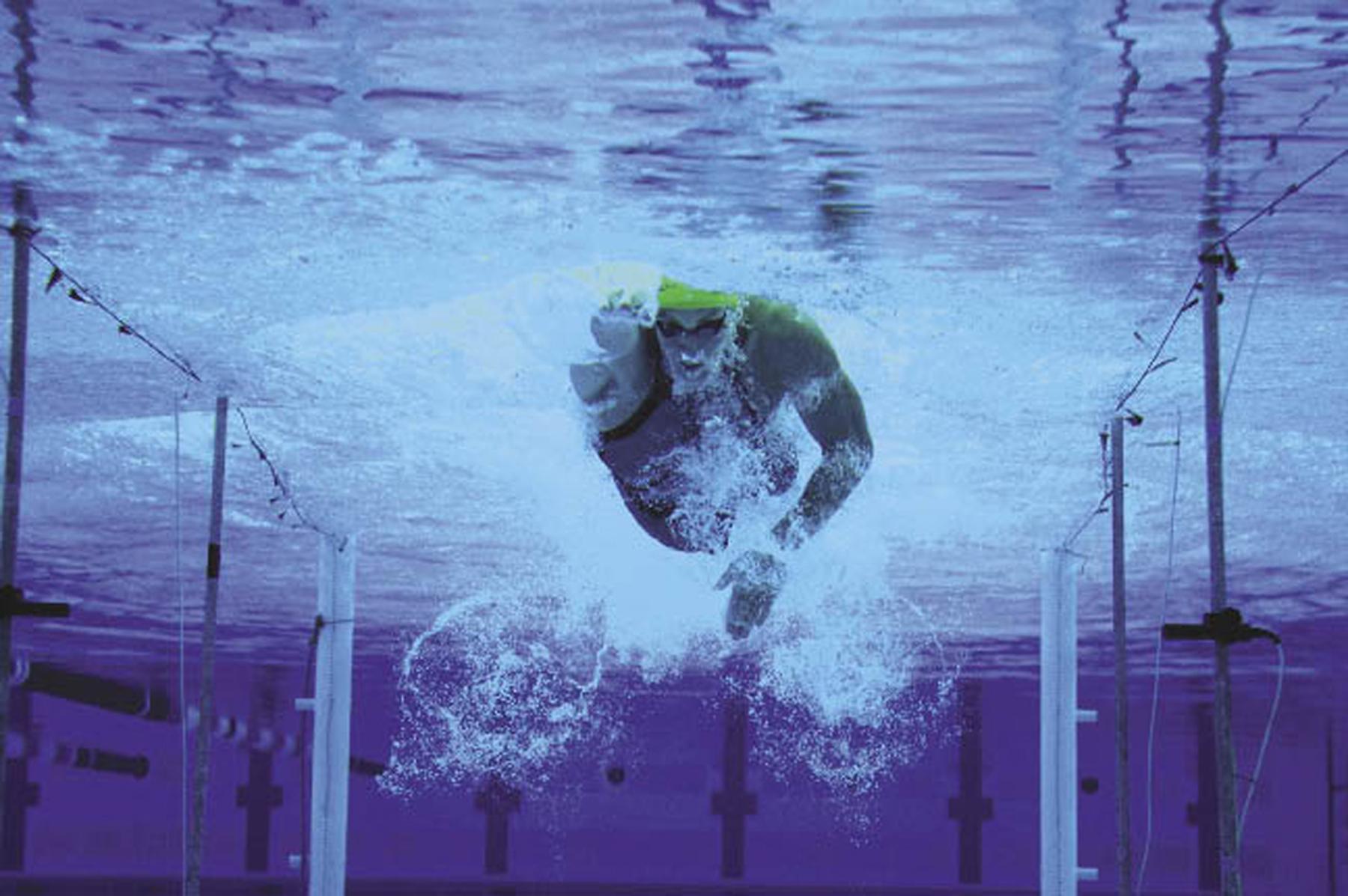 An athlete swims toward the camera.