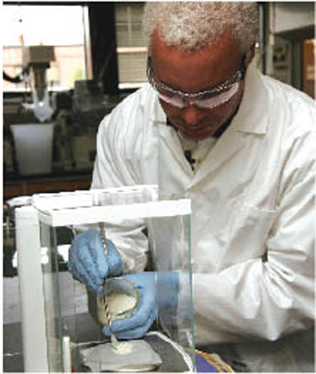 LaRC-SI is applied to another material in a laboratory.
