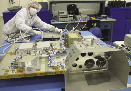 A worker assembling electronics for the LCROSS mission
