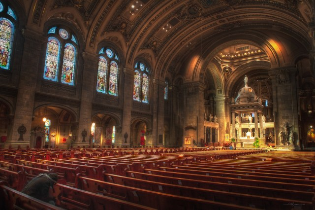 Photo of the inside of the Basilica of Saint Mary. The stained glass windows and high arching domed roof are breathtaking. Photo Credit:Spintheglobe.net