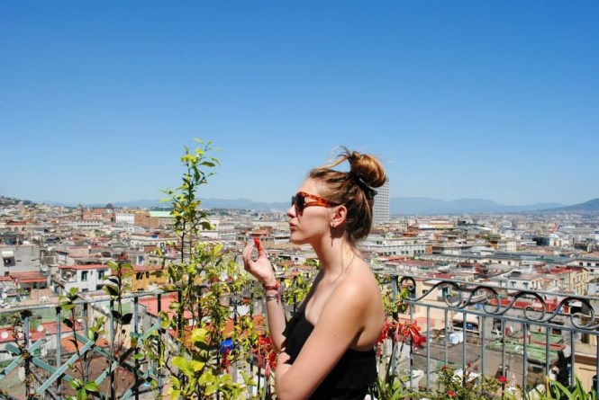 Eating strawberries on the roof in Naples, Italy
