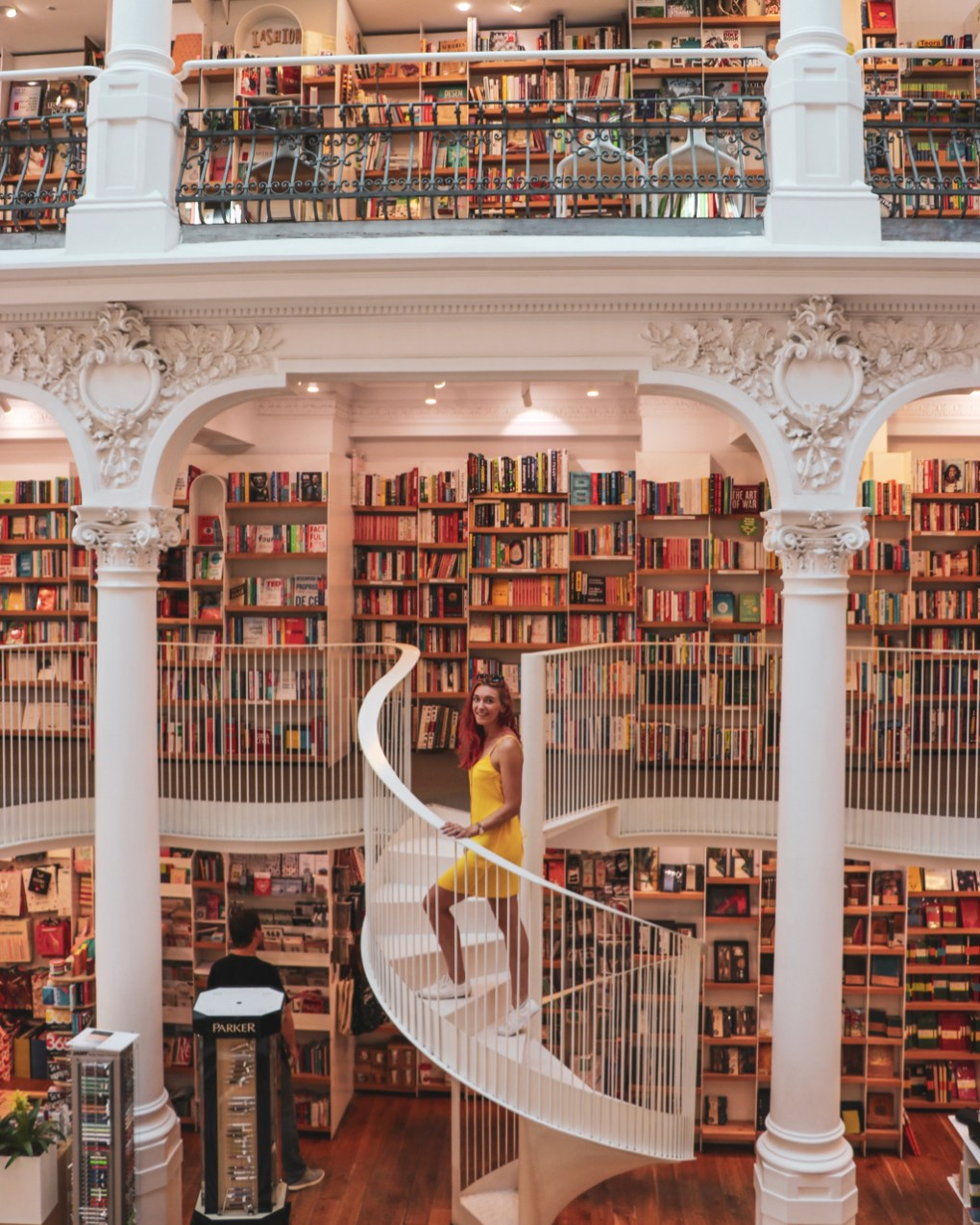 I'm standing on a spiral staircase in the bookstore. 11 must-visit photo spots in Bucharest - spinthewindrose.com