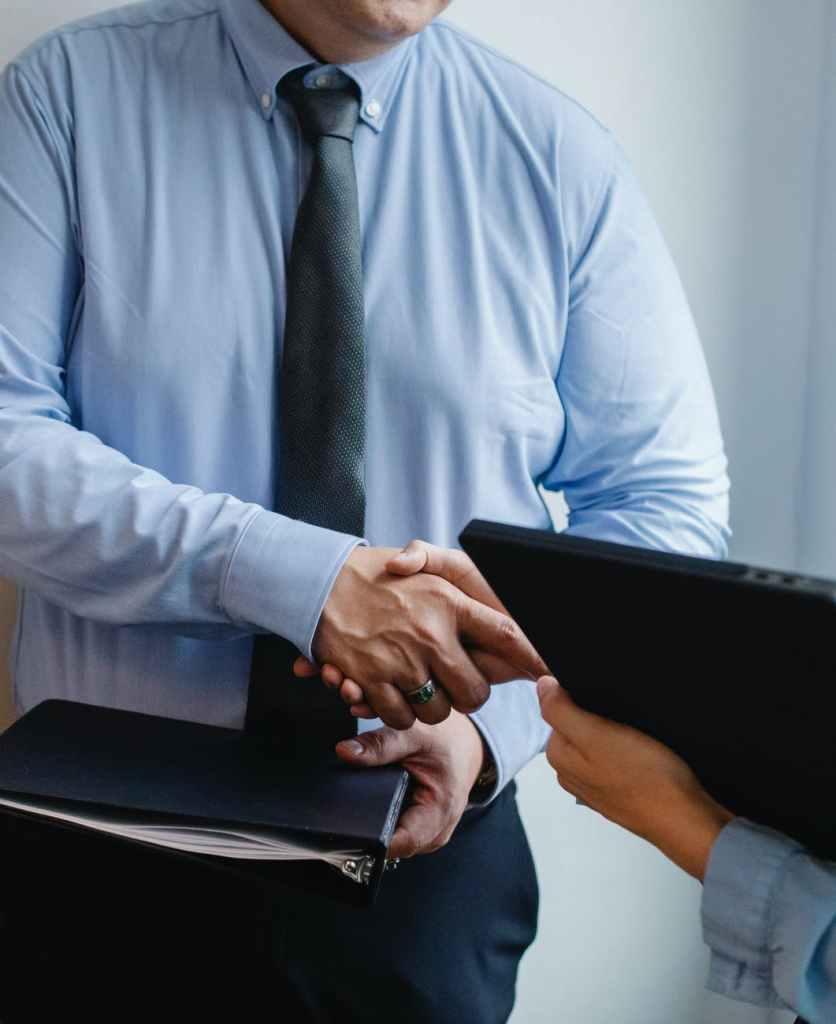 entrepreneurs shaking hands after agreement