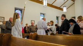 Fr. Jim reads the Gospel Image credit: Gary Allman