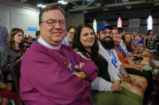 Bishop Marty, youth and delegates get ready for the closing Eucharist. Image: Gary Allman