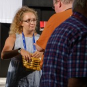 Katie Mansfield serving communion bread at the General Convention Closing Eucharist. Image: Gary Allman