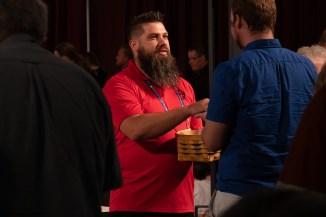 Josh Trader serving communion bread at the General Convention Closing Eucharist. Image: Gary Allman