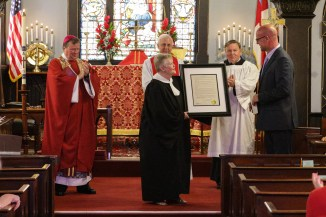 Sr. Warden Beverly Roggenkamp receiving the proclamation from Mayor Fred Wiedner. Christ Church Lexington - 175th Anniversary. Image credit: Tim Ross