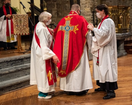 Vesting by the Rev. Deacon Sherrill Russell and the Very Rev. Chas Marks. The Ordination of Isaac Ross Petty to the Sacred Order of Priests at Grace and Holy Trinity Cathedral, Kansas City, Missouri. Image credit: Gary Allman