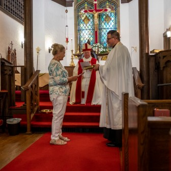Presentation of the Book of Common Prayer - The Installation of the Rev. Isaac Petty as Priest in Charge at St. Luke's Episcopal Church, Excelsior Springs, Missouri. Image credit: Gary Allman