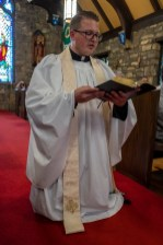 'The new Minister kneels in the midst of the church as says...' The Installation of the Rev. Isaac Petty as Priest in Charge at St. Luke's Episcopal Church, Excelsior Springs, Missouri. Image credit: Gary Allman