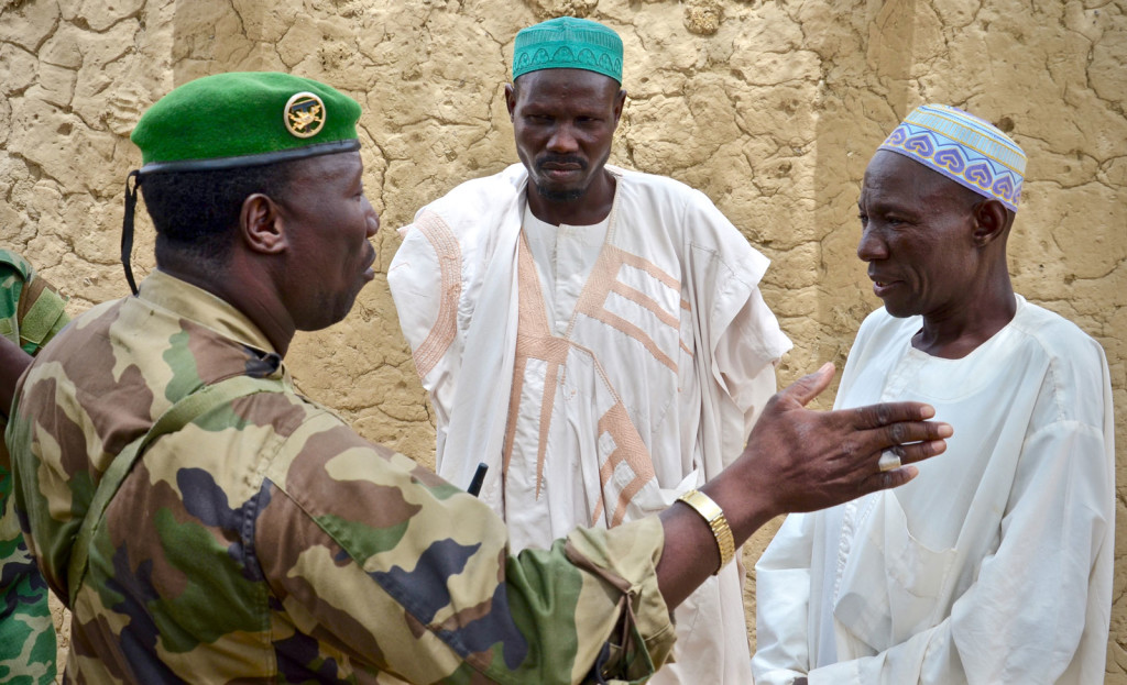 Sergeant Fougou, the local ACM Team Leader, discusses a recent Boko Haram attack with village leaders.