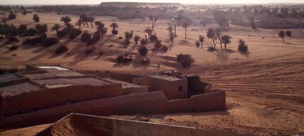 The city of Faya and its surrounding date-palm groves bake in the Saharan sun