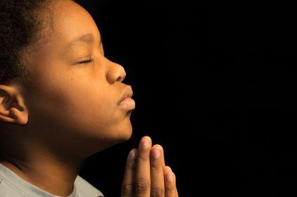 A young boy offers prayer.