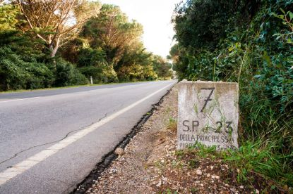 Old milestone along the Strada Provinciale 7 in Tuscany, Italy. Celebrating milestones as a family is important.