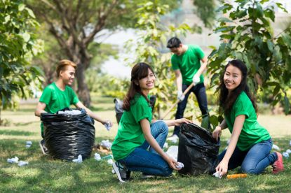 A group of volunteers cleaning up trash. Choosing loving others over selfishness.
